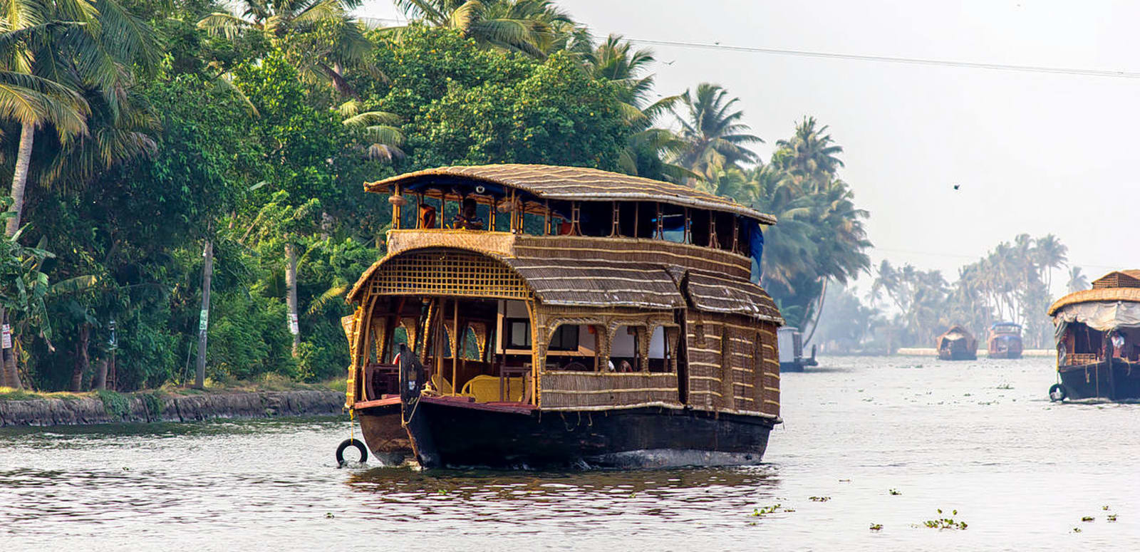 1493301611_1280px-houseboat_in_alleppey_(7057374293).jpg
