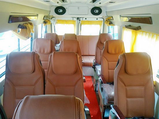 1588240188_14-seater-luxury-tempo.jpg