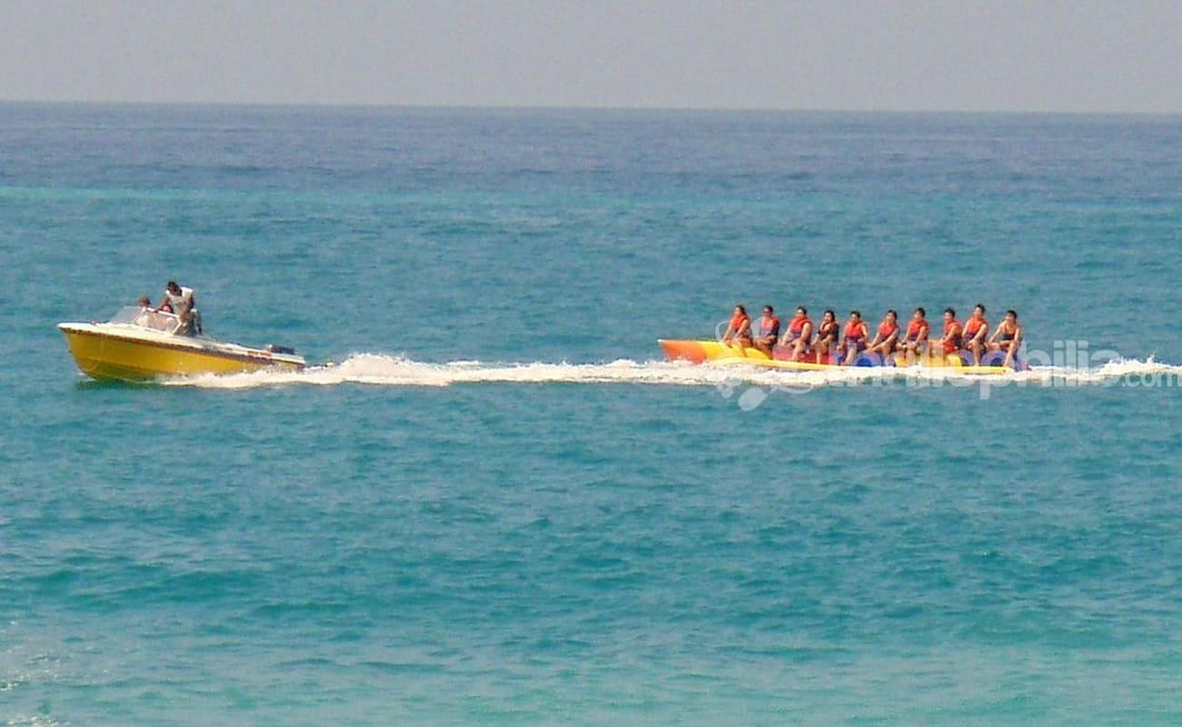 the banana boat ride This exciting combination of watersports takes you out from the tanjung benoa beach resort for a jet ski ride, parasailing, and a banana-boat cruise along the coast.