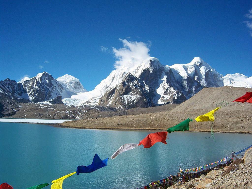 1513347848_buddhist_flag_flutters_in_gurudongmar_lake.jpg