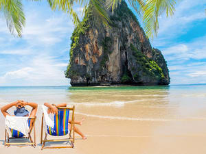 1550212245_couple-of-tourists-on-the-beach-in-thailand-copy-2.jpg