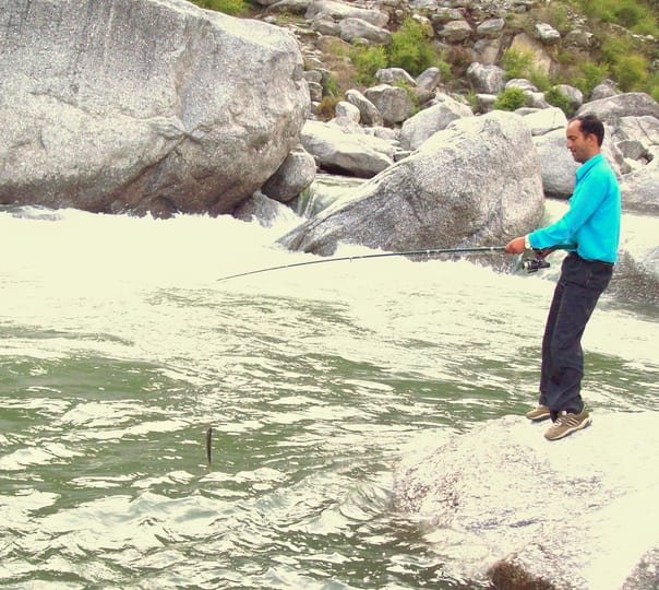 Fishing Activities at the Riverside in Barot