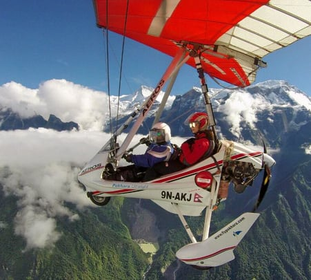 Microlight Flying over Mountain Trek Route