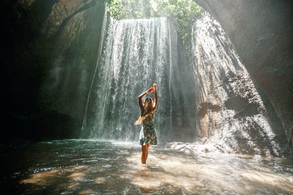Visit Tukad Cepung Waterfall