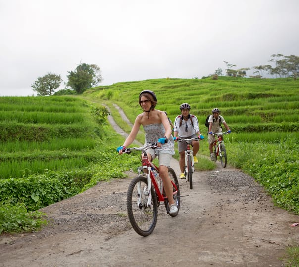 Cycling through the Rice Paddy at Jatiluwih in Bali