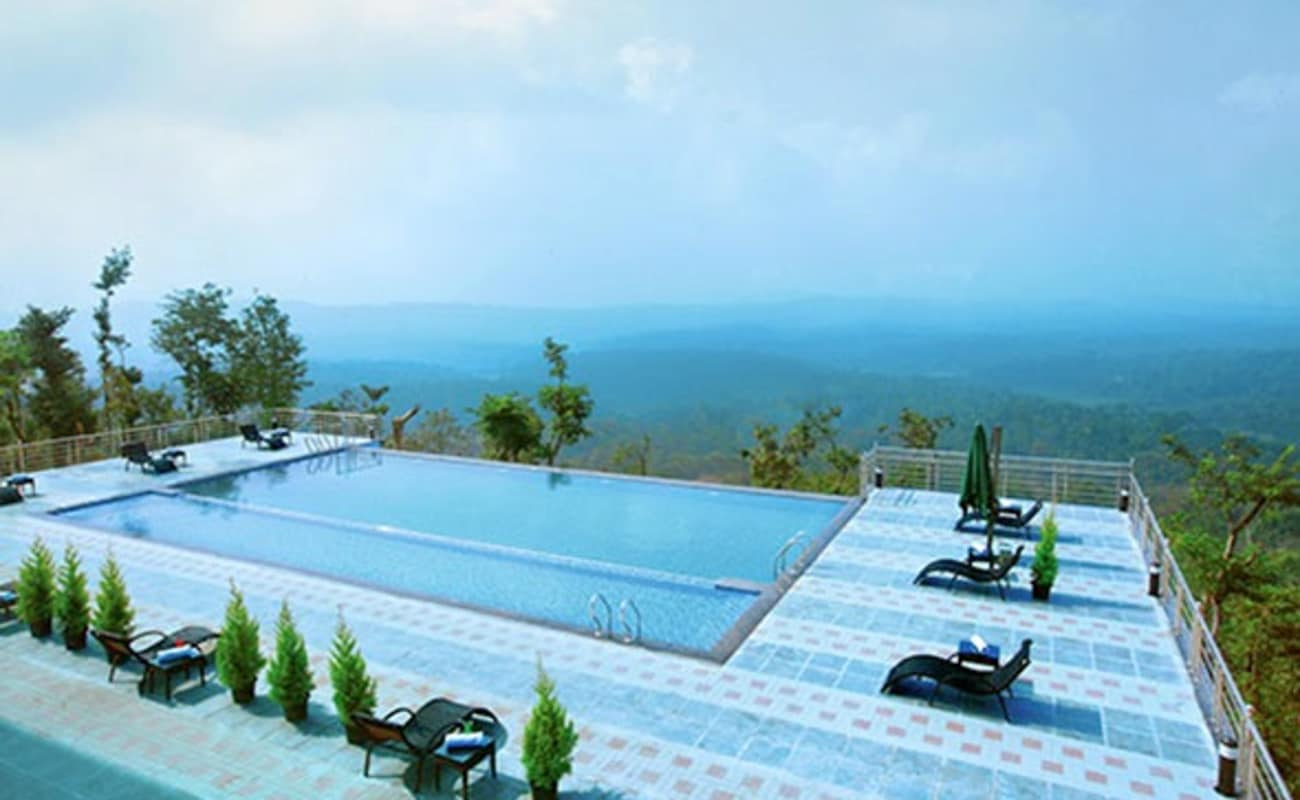 Stay at coorg cliffs resort thrillophilia Hotels in coorg with swimming pool