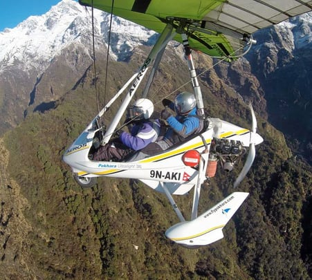 Microlight Flying over Himalayas