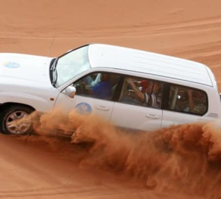 Evening Desert Safari, Sand Boarding, and Camel Ride in Dubai
